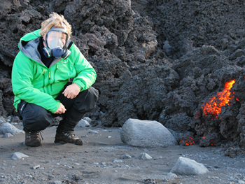 Image contains: Person, Volcano and lava
