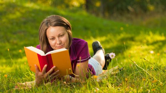 Picture of a woman reading a book.